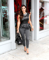 Kim Kardashian looking hot in tight jeans and black top