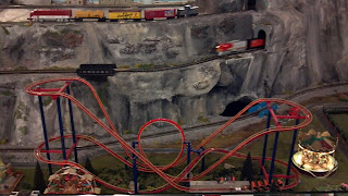 mini roller coaster as part of a model train display