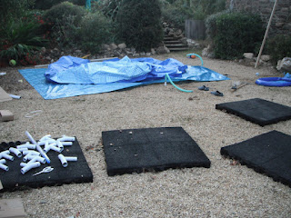 Tarpaulins over the gravel ready for the new pool to be put up