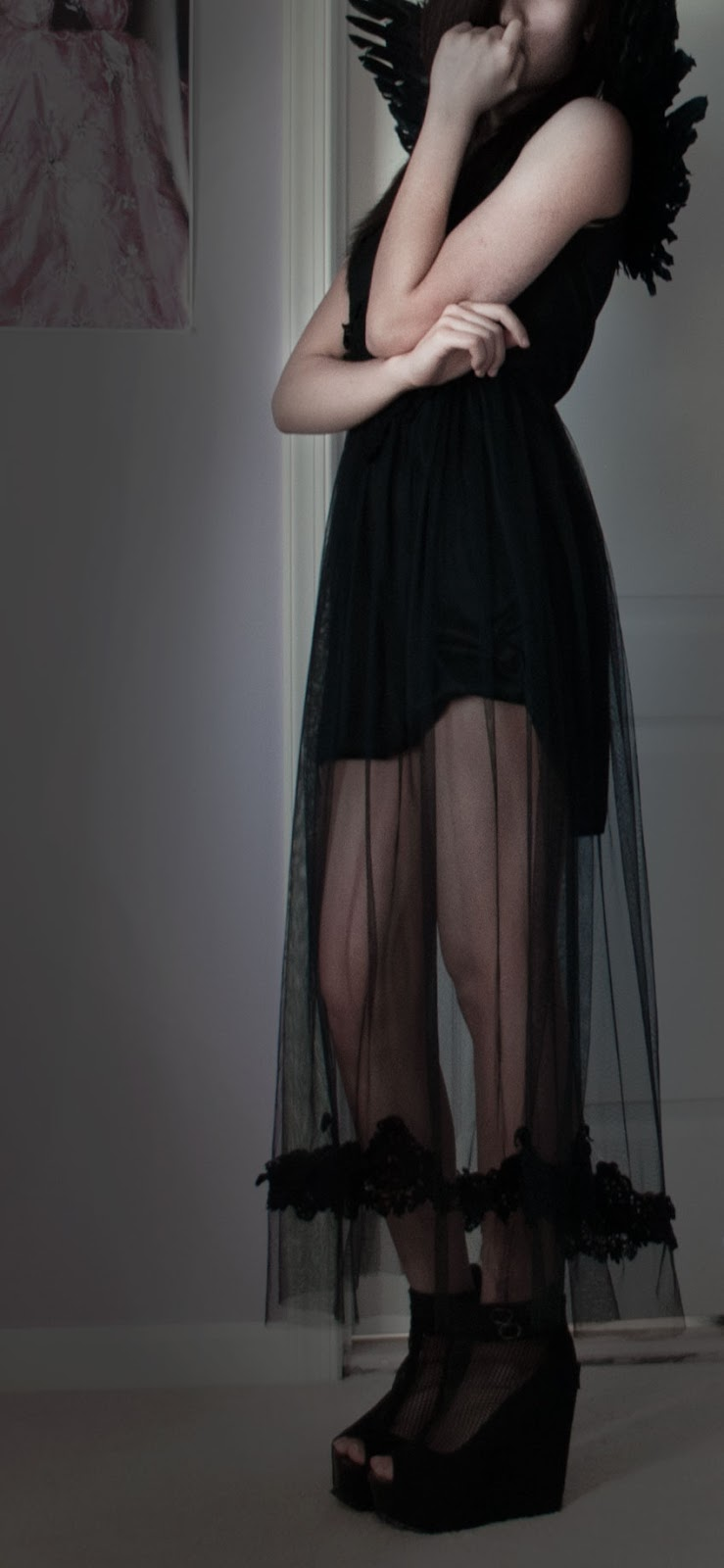 Dark Angel Halloween Look: full-body outfit with long mesh maxi dress, angel wings, and black wedges