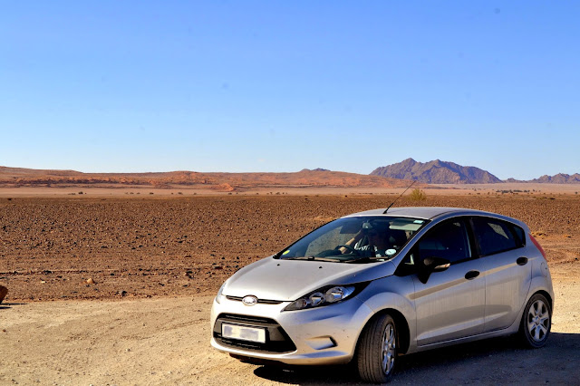 Car in desert landscape