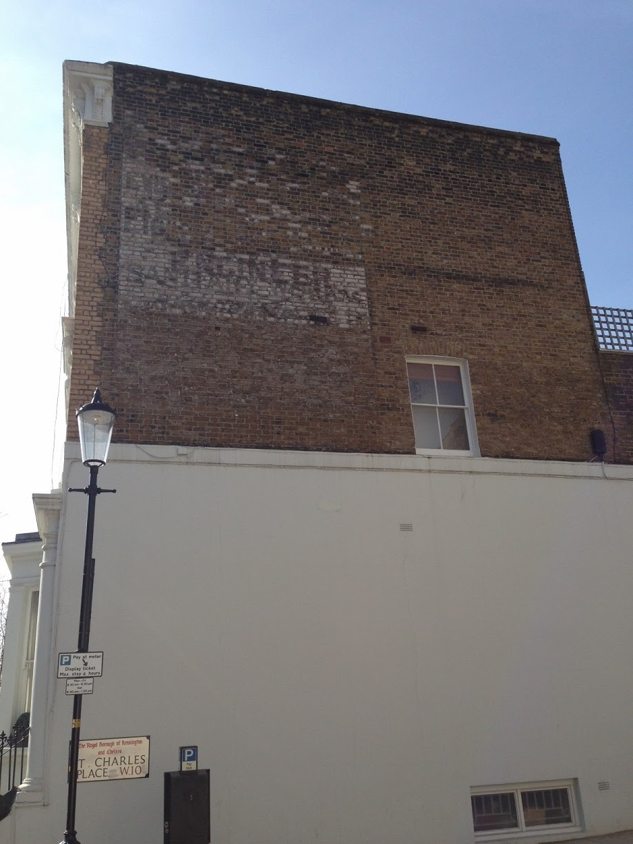 Ghost sign in Charles Place, London