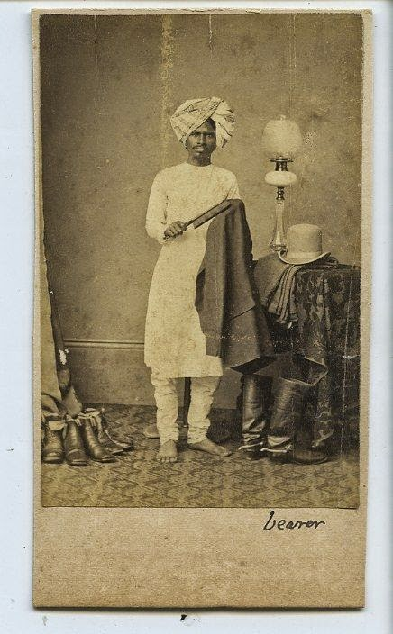 Indian Servant Brushing Employer's Jacket - c1870's
