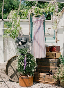 Our trunks, suitcases, hat box, vintage dress and basket used for a shoot