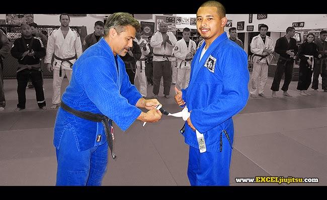 BJJ Professor Michio Grubbs awarding Daryl Guy 1 stripe Jiu Jitsu White Belt