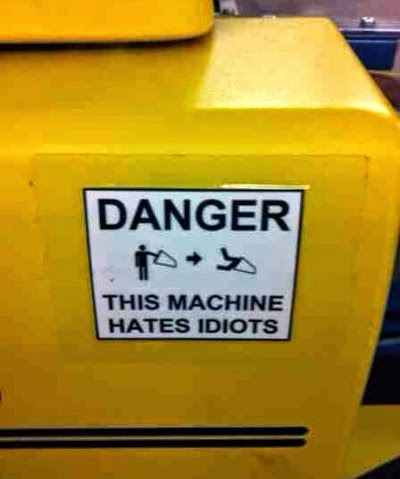 http://www.funnysigns.net/this-machine-hates-idiots/