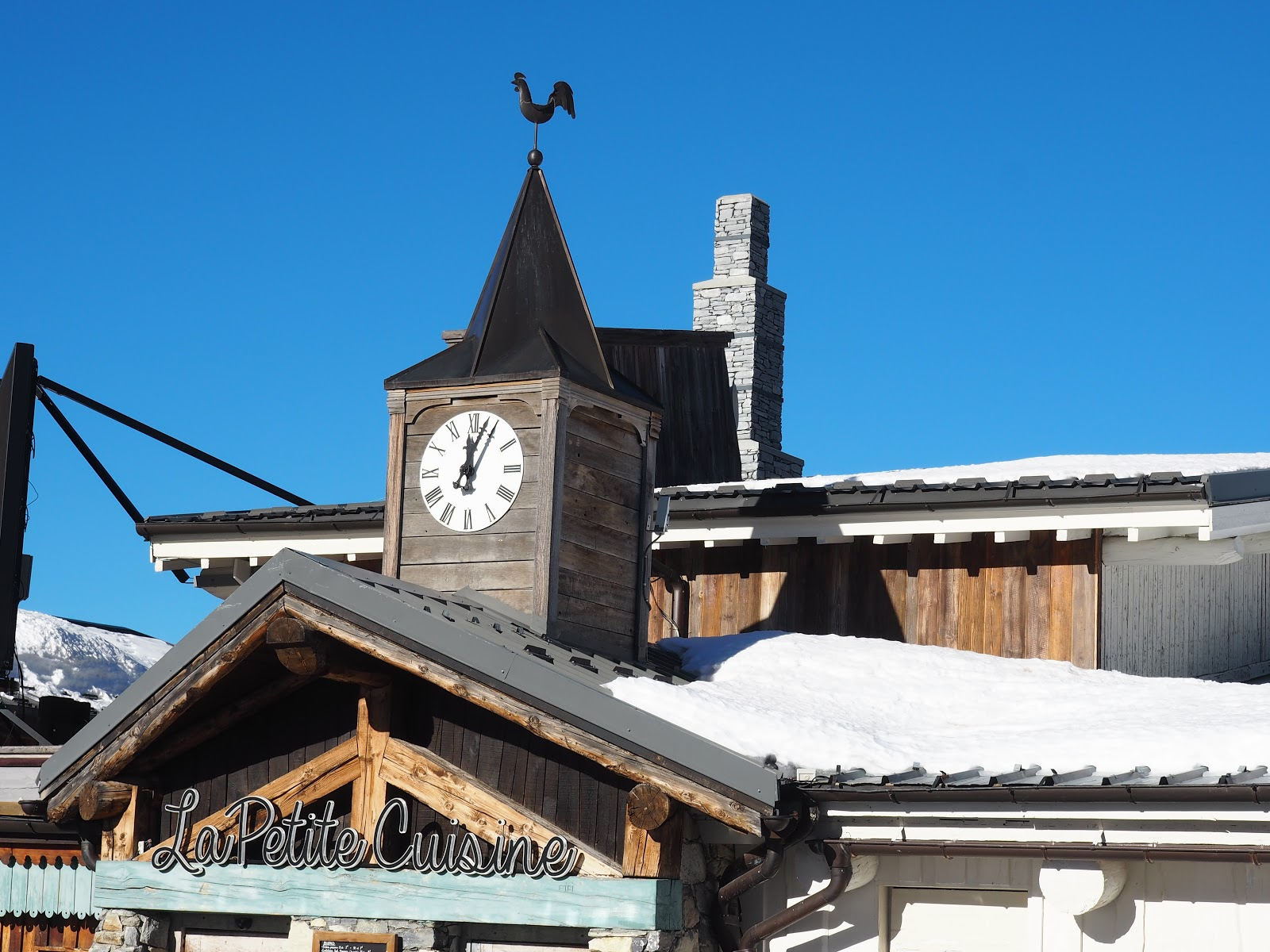 Le Petite Cuisine, Val d'Isere, France against blue sky