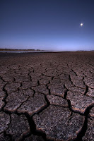 Parched earth waiting for the rain, by Josh Sommers