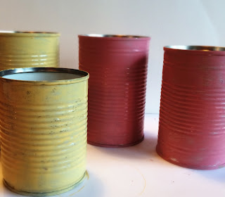 Yellow and pink painted tins using chalk paint