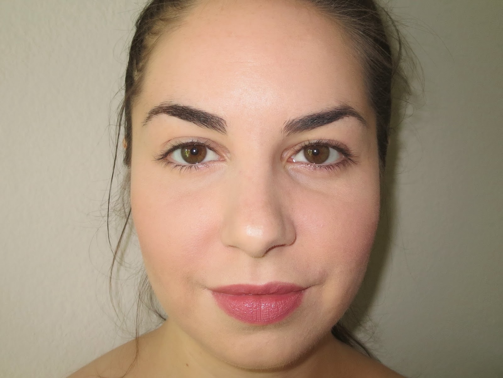 a picture of  Final results Physician's Formula Touch of Glow Foundation in Light on face