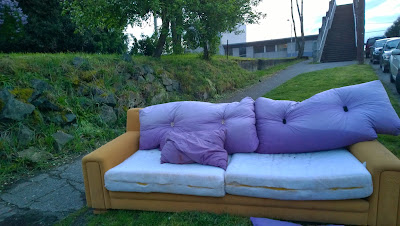 A sight for sore eyes this tan couch with lavender pillows at Winslow Pl N and N 41 Street