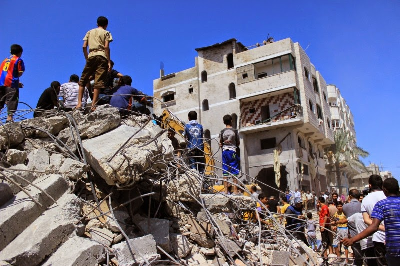 Israeli airstrikes on the Gaza Strip continued on Aug. 20, 2014, targeting a home  in the city of Deir al-Balah. Photo by Hussain Abdel Jawwad. Copyright Demotix