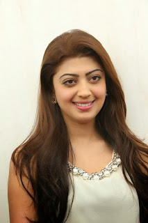 Actress Pranitha Pictures in White Dress at Homeo Trend Super Speciality Hospital Launch 0006
