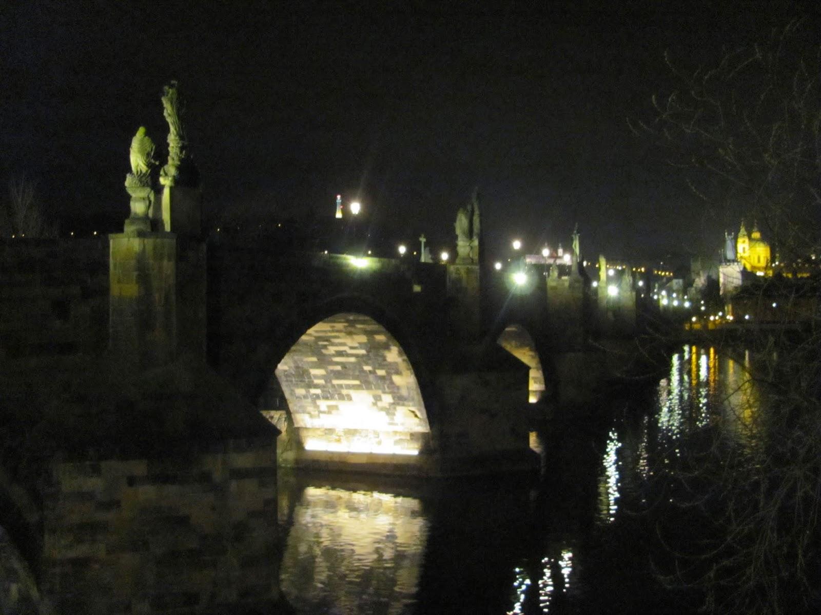 Charles Bridge's Illuminated Arches in Prague