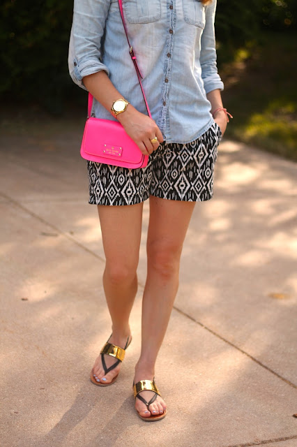 chambray button up, black and white ikat shorts, black and gold sandals, pink kate spade bag, ray ban aviators