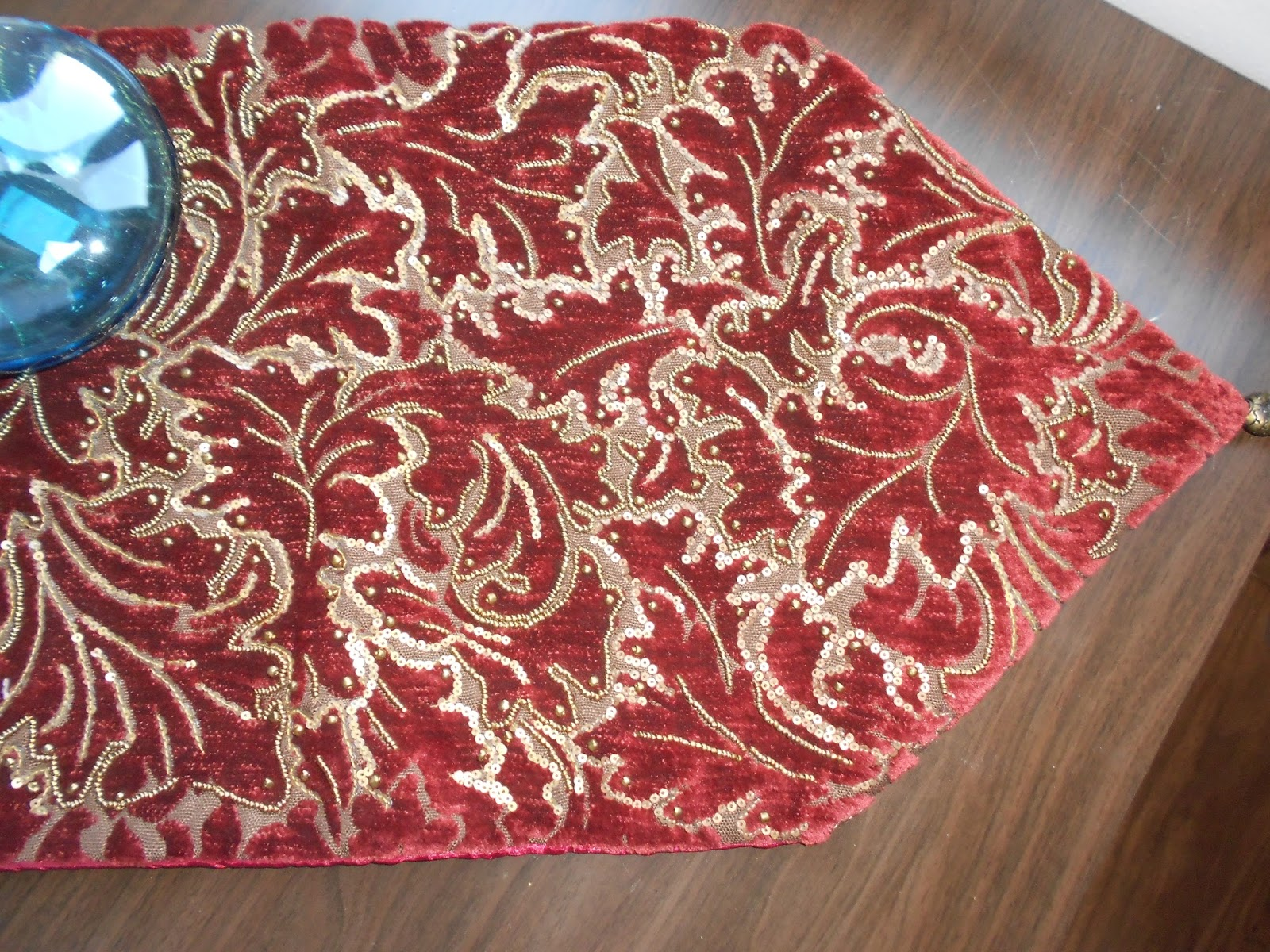 Maroon Jacquard Table Runner With Heavy Bead Work.