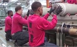 U.S. Navy Sailors Assemble GBU-54 Bombs