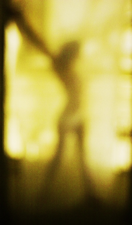 naked woman behind glass,