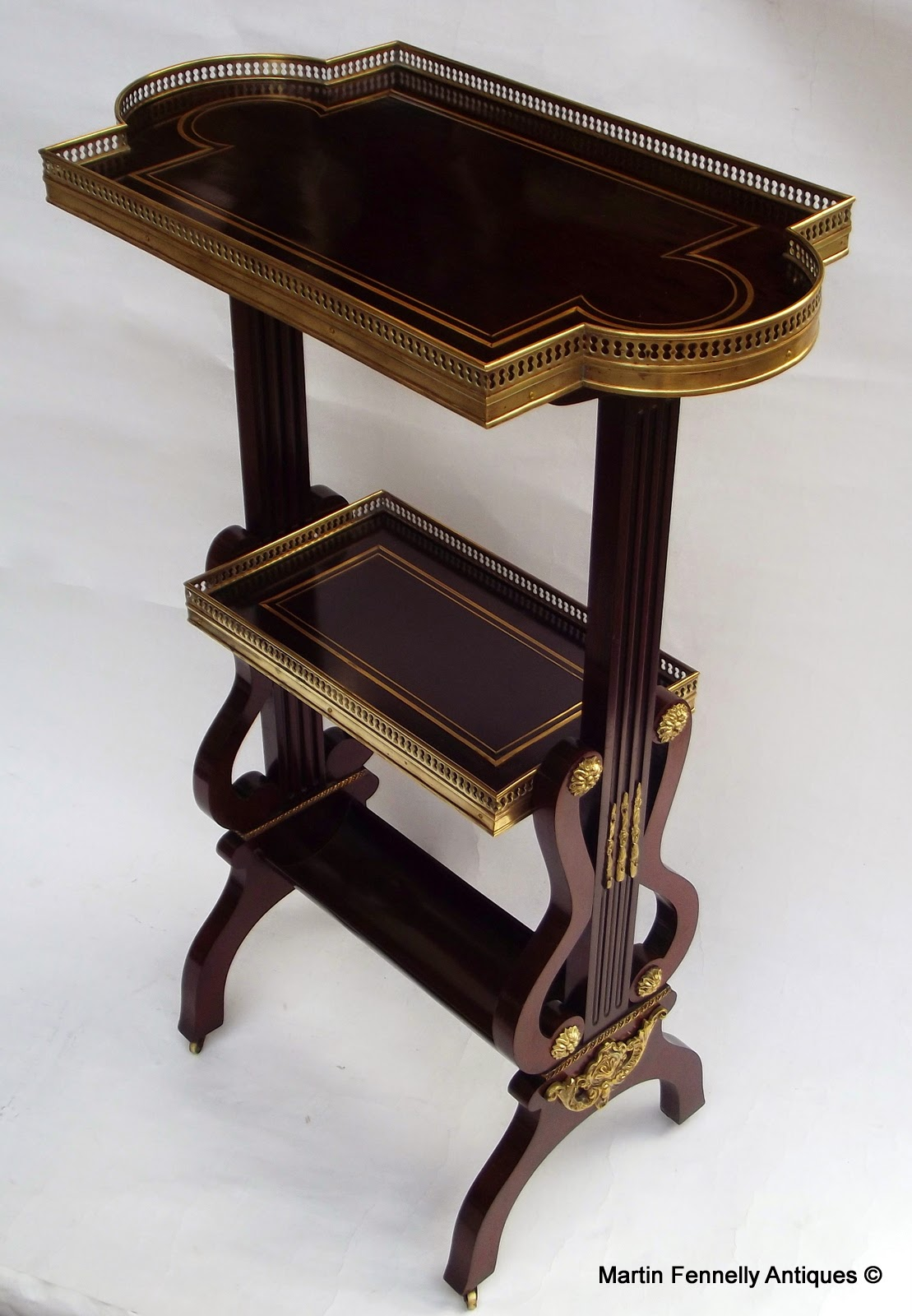 http://www.fennelly.net/Antiques/Newest%20Listings%20-%20Art%20and%20Antique%20Gallery%20Dublin/523%20French%20Rosewood%20Gilt%20Brass%20Inlaid%20Occasional%20Table%20-%20Circa%201880.aspx