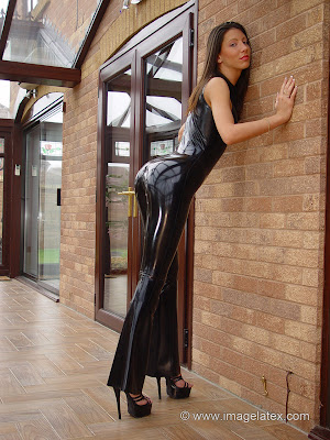 Sultry Brunette Candice perfect body in tight black latex catsuit and heels