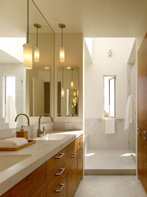 Bathroom with Wooden Vanity and White Sinks in Home on Grey Floor