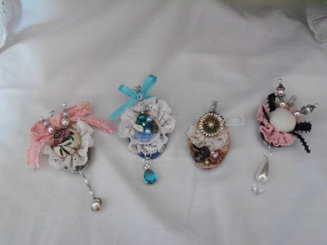 Four altered spoon charms
