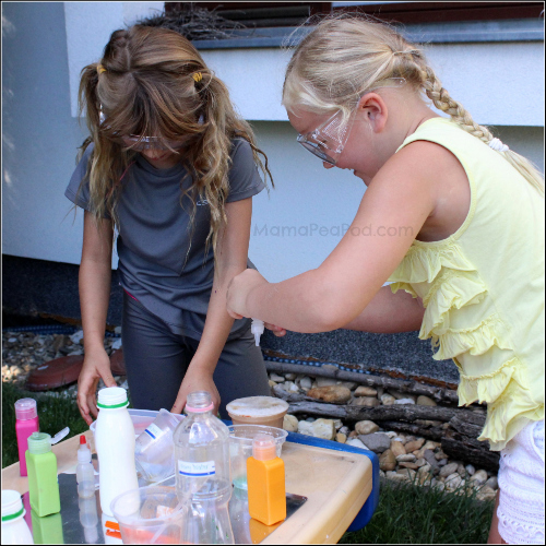 girls science experiment mixing potions