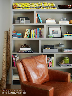 a warm chocolate sofa and a minimalist rack for books and decorations