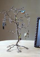 https://www.etsy.com/listing/104227869/jewelry-tree-stand-bronze-earring