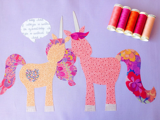 Two unicorns talking quilt block with Liberty fabric tails
