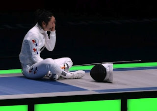 South Korean fencer Shin A Lam waits out the Korean protest of her loss