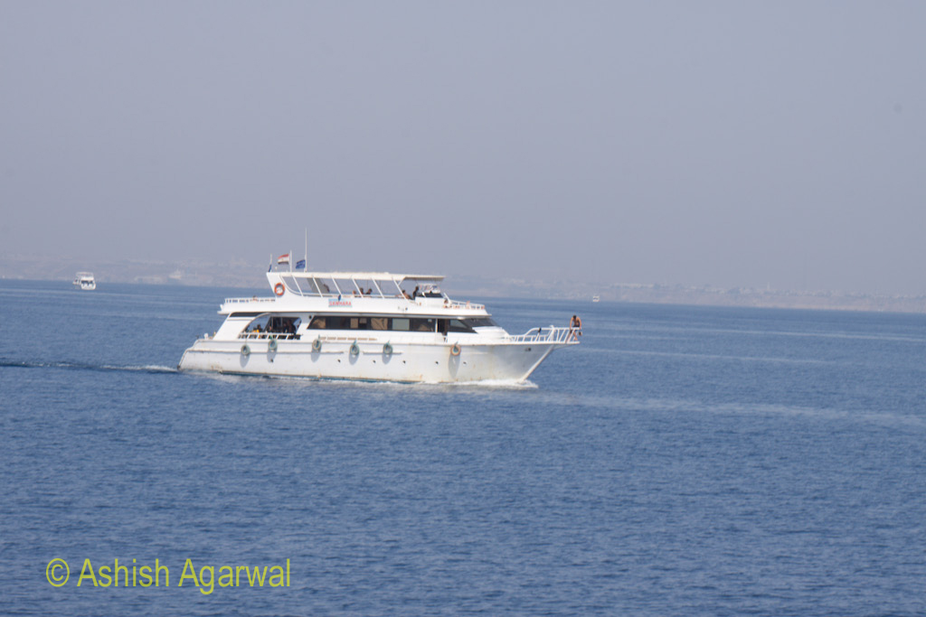 A small tourist ship in the Red Sea with the Egyptian flag on top