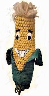 puxa saco ou porta sacolas em crochê em formato de milho verde