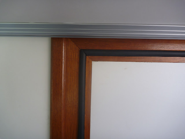 The hollow bulb seal fitted to the inside of the bathroom door frame to prevent water leaking from the shower.