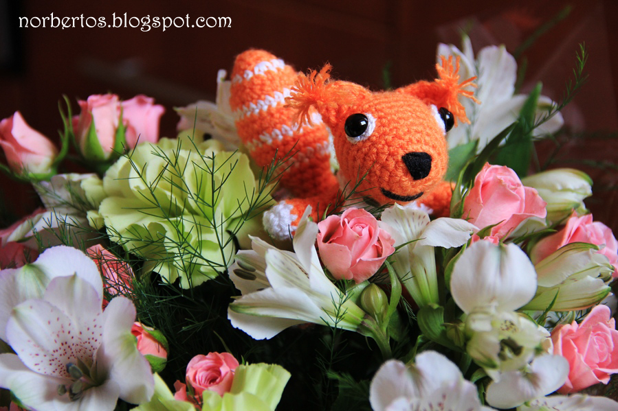 Crochet squirrel with flowers