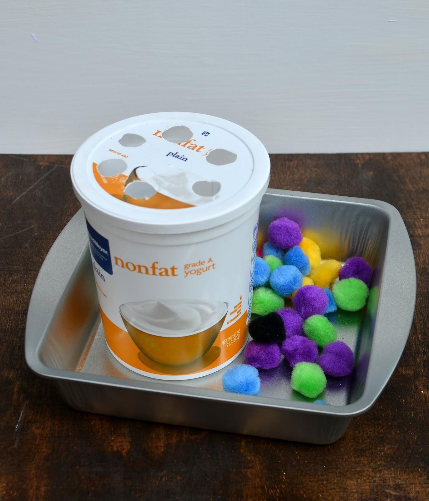 toddler sensory activities, yogurt container and fluff balls