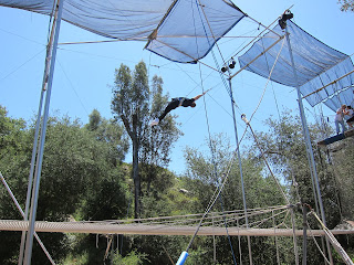 Noah's first swing on the flying trapeze.