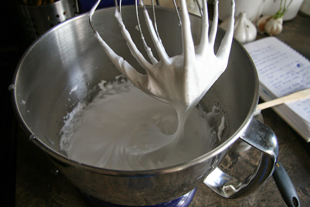 The forming of the Italian meringue after hot syrup is poured into the whisked egg whites.