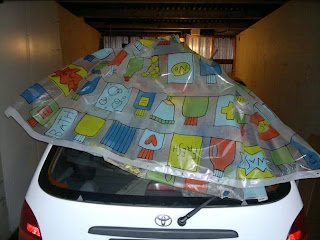 Making a tent for the car??? No, just kidding. I am not THAT strange :)
