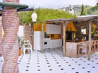 Outdoor kitchens and reality tv courtney scrabeck for Spanish outdoor kitchen designs