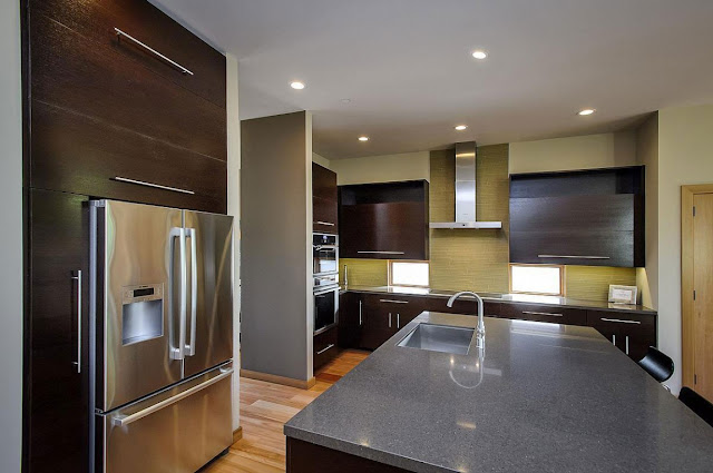 Modern brown kitchen in the Contemporary Style Home in Burlingame