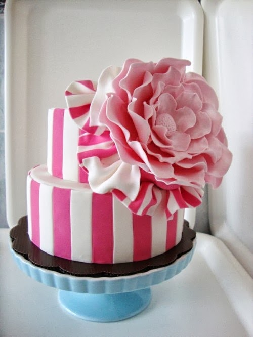 White and pink striped cake with peony