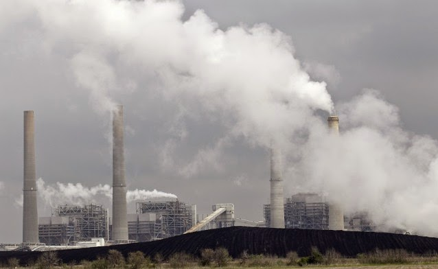 Piles of coal are shown at NRG Energy's W.A. Parish Electric Generating Station Wednesday, March 16, 2011, in Thompsons, Texas. The plant, which operates natural gas and coal-fired units, is one of the largest power plants in the United States. (Credit: AP) Click to Enlarge.
