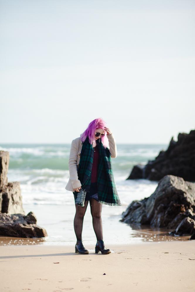 girl walking on the beach in the sunshine
