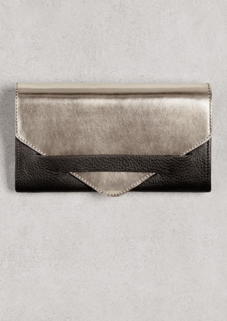stories metallic clutch, black and gold clutch,