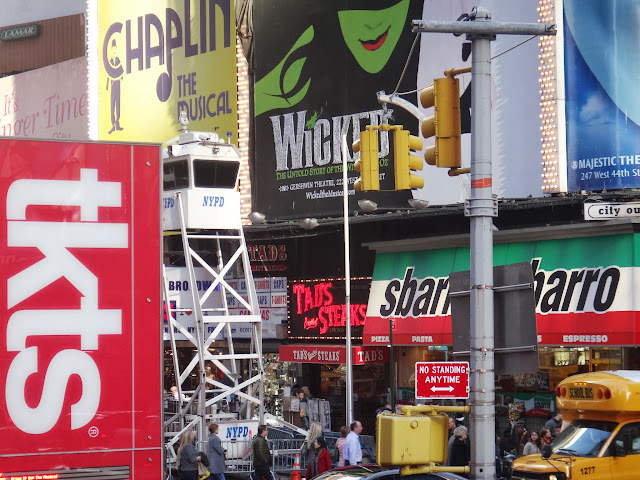 NYPD Surveillance Booth at the crowded area in Times Square in New York City, New York, USA
