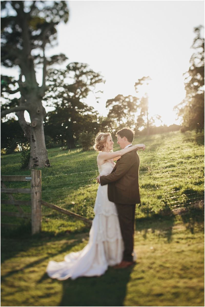 Bride and groom in sunset