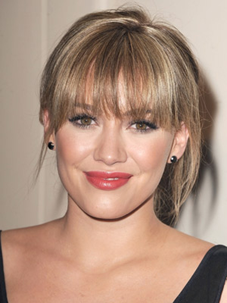 Hilary Duff shows off her brow-grazing bangs with a wispy hairstyle