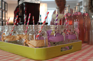 mason jar glasses with ribbon and paper straw