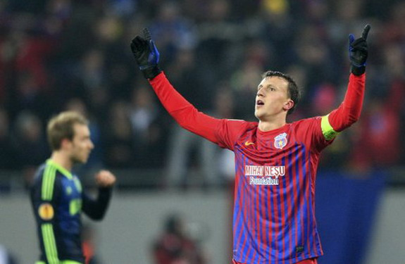 Steaua Bucureşti player Vlad Chiricheş celebrates after scoring a goal against Ajax
